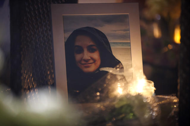 <p>A photograph of Anne Marie D'Amico, a victim of the mass killing, is shown at a vigil on April 24, 2018 in Toronto, Canada. (Photo: Cole Burston/Getty Images) </p>