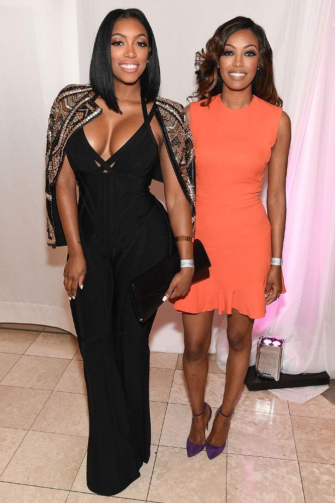 Porsha Williams (left) and her sister Lauren | Paras Griffin/Getty