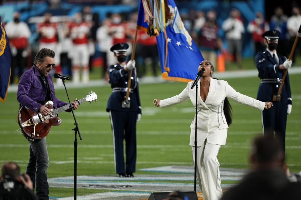 Eric Church and Jazmine Sullivan performs the national anthem before the NFL Super Bowl 55 football game between the Kansas City Chiefs and Tampa Bay Buccaneers, Sunday, Feb. 7, 2021, in Tampa, Fla. (AP Photo/David J. Phillip)