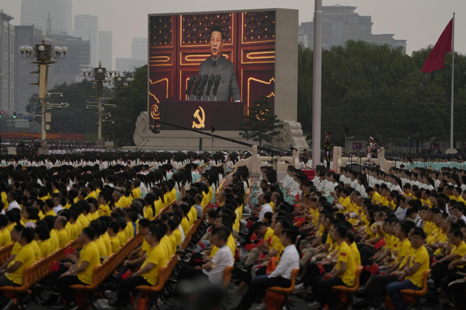 A screen shows Chinese President Xi Jinping speak during a ceremony to mark the 100th anniversary of the founding of the ruling Chinese Communist Party at Tiananmen Square in Beijing Thursday, July 1, 2021. (AP Photo/Ng Han Guan)