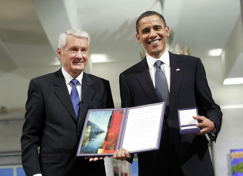 Barack Obama accepting his Nobel Peace Prize from Thorbjorn Jagland, chair of the Norwegian Nobel Committee, in December 2009: Getty