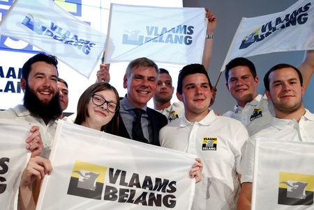 Flemish separatist party Vlaams Belang reacts after the Belgian general and regional elections and European Parliament elections in Londerzeel