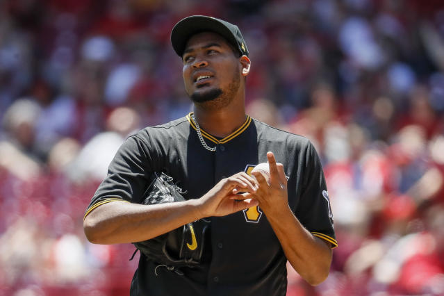 Pittsburgh Pirates starting pitcher Ivan Nova reacts after loading the bases on a fielding error in the third inning of a baseball game against the Cincinnati Reds, Thursday, May 24, 2018, in Cincinnati. (AP Photo/John Minchillo)