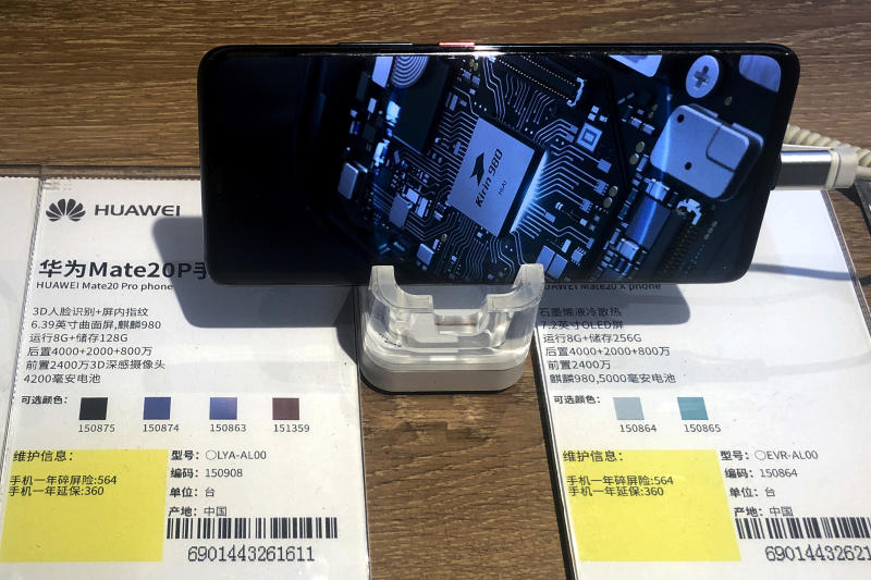 A Huawei Mate20P smartphone model showing its own Kirin chip processor is displayed at an electronic store in Beijing, Monday, May 20, 2019. Google assured users of Huawei smartphones on Monday the American company's basic services will work on them following U.S. government cubs on doing business with the Chinese tech giant. The announcement highlighted the potential impact on global consumers and technology industries of the Trump administration's decision to tighten controls on Huawei Technologies Ltd., which Washington says is a security threat. (AP Photo/Andy Wong)