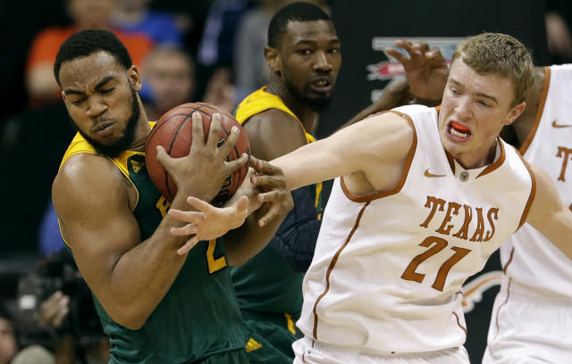 Texas' Connor Lammert (21) tries to steal the ball from Baylor's Rico Gathers, left, during the second half of an NCAA college basketball game in the Big 12 men's tournament Friday, March 14, 2014, in Kansas City, Mo. Baylor won 86-69. (AP Photo/Charlie Riedel)