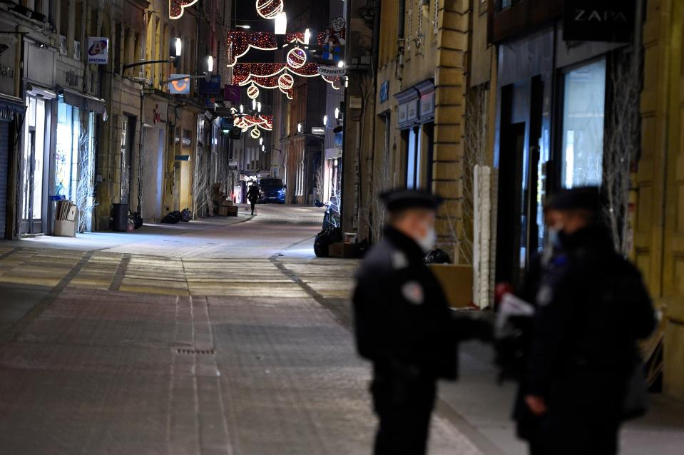 French policemen stand on a deserted street on January 5, 2021 in Metz. (Getty)