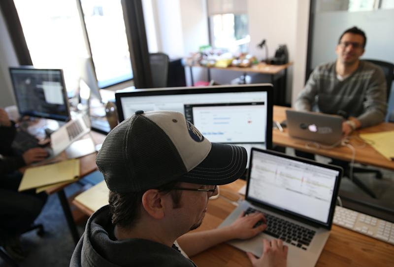 BOSTON - MARCH 19: WeWork is a company that offers entrepreneurs and small businesses workspace in a collaborative community, connective technology and other services. Zefr employee Doug Hogan at the company's Boston WeWork location. (Photo by Jonathan Wiggs/The Boston Globe via Getty Images)