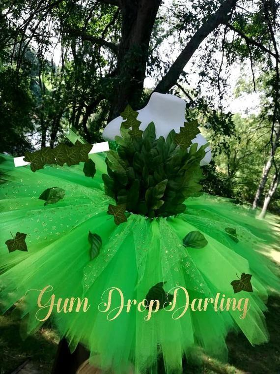 """<p><strong>GumDropDarling</strong></p><p>etsy.com</p><p><strong>$60.08</strong></p><p><a href=""""https://go.redirectingat.com?id=74968X1596630&url=https%3A%2F%2Fwww.etsy.com%2Flisting%2F716426708%2Fpoison-ivy-dress-poison-ivy-costume&sref=https%3A%2F%2Fwww.countryliving.com%2Fdiy-crafts%2Fg29402429%2Fdiy-poison-ivy-costume%2F"""" rel=""""nofollow noopener"""" target=""""_blank"""" data-ylk=""""slk:Shop Now"""" class=""""link rapid-noclick-resp"""">Shop Now</a></p><p>Who knew that evil could look so sweet? With this fluffy green neon tutu, your child will be able to embrace the key feature of Poison Ivy while still looking adorable.</p>"""