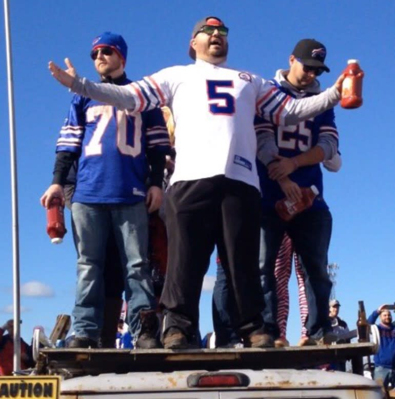 Nick Papagelis (center) explains the two factions of Bills Mafia: