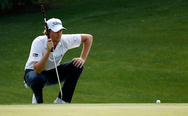 CHARLOTTE, NC - MAY 06: Webb Simpson of the United States lines up his putt on the eighth hole during the final round of the Wells Fargo Championship at the Quail Hollow Club on May 6, 2012 in Charlotte, North Carolina. (Photo by Streeter Lecka/Getty Images)