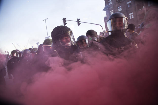 <p>Police Forces clash with protesters during a march on July 6, 2017 in Hamburg, Germany. Leaders of the G20 group of nations are arriving in Hamburg today for the July 7-8 economic summit and authorities are bracing for large-scale and disruptive protest efforts and heavy protests are expected tonight at the 'Welcome to Hell' anti-G20 protest. (Photo: Maciej Luczniewski/NurPhoto via Getty Images) </p>