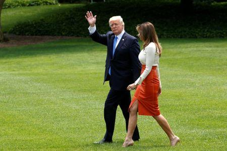 U.S. President Donald Trump and Melania Trump depart the White House to embark on a trip to the Middle East and Europe, in Washington, U.S., May 19, 2017. REUTERS/Kevin Lamarque