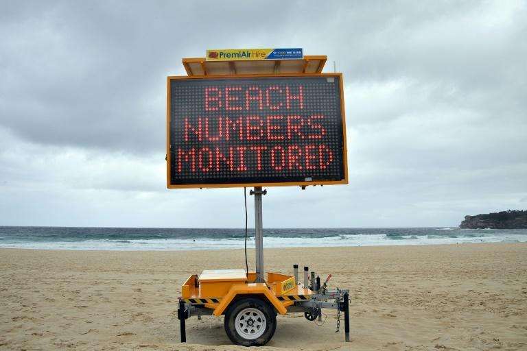The usual picnicking crowds avoided the sands of Sydney's famous Bondi Beach, while the waves were empty of surfing Santas