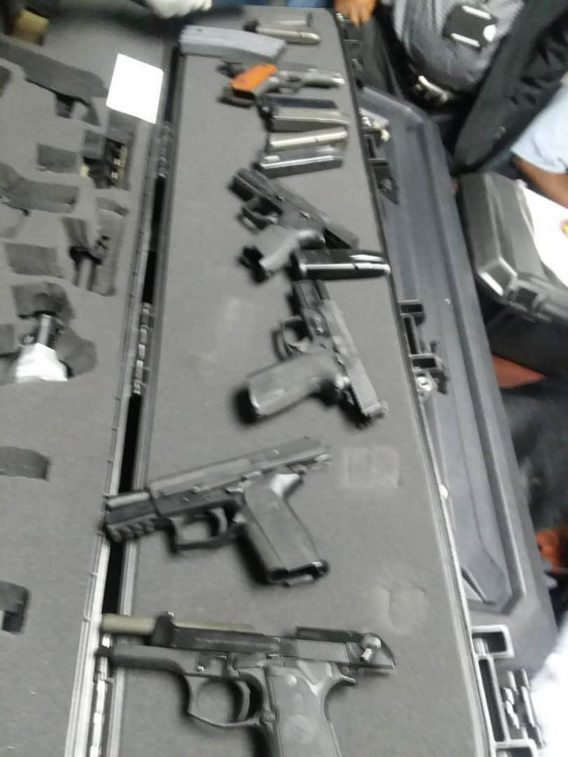 This photo of the weapons brought into Haiti by Jacques Yves Duroseau was circulated on social media after Duroseau's arrest in Port-au-Prince Tuesday after arriving aboard an American Airlines flight from Miami. Two police officials confirmed that the photos are from the incident.