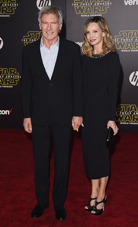 <p>Harrison Ford, who is back as flyboy Han Solo, walks the red carpet with wife Calista Flockhart. (Getty)</p>
