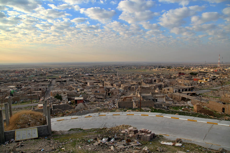 A view of deserted ruins in the northern Iraqi town of Sinjar, where the Iraqi army recently moved in to restore federal government control. Friday, Dec. 4, 2020. A new agreement aims to bring order to Iraq's northern region of Sinjar, home to the Yazidi religious minority brutalized by the Islamic State group. Since IS's fall, a tangled web of militia forces have run the area, near the Syrian border. Now their flags are coming down, and the Iraqi military has deployed in Sinjar for the first time in nearly 20 years. (AP Photo/Samya Kullab)