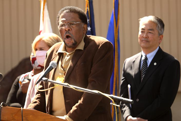 Chief Duane Yellow Feather Shepard, Sr., gives an impassioned speech in Los Angeles in April, calling for the return of the land that used to belong to his family. He is flanked by Los Angeles County Supervisor Janice Hahn, left, California Assemblyman Al Muratsuchi.