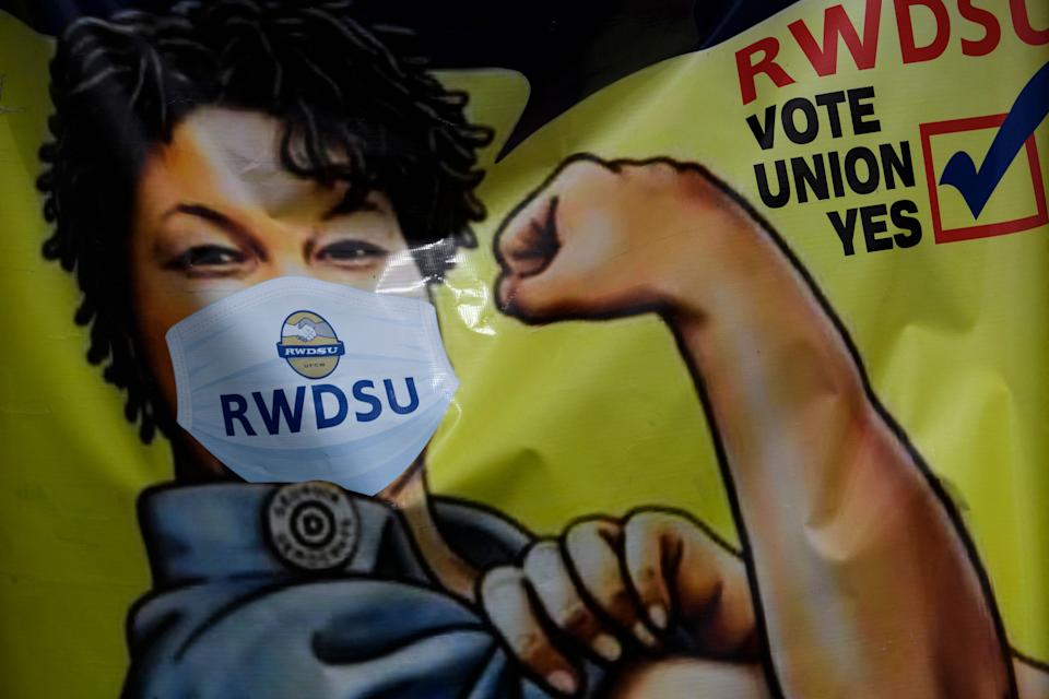 Union-friendly voting signage will be posted outside the Amazon.com, Inc. fulfillment center in Bessemer, Alabama on March 26, 2021.  - Senator Bernie Sanders joined the campaign on March 26, 2021 to help Amazon workers in Alabama with the Retail, Wholesale and Department Store Union (RWDSU) in Birmingham, as the clashes between lawmakers and e-commerce broke out -Giants stepped up ahead of a deadline for a vote that could result in the first union on US soil at the giant tech company.  The visit is the latest high-profile appearance in the controversial organizational effort for around 5,800 employees in the Amazon warehouse in Bessemer, which will culminate next week.  (Photo by Patrick T. FALLON / AFP) (Photo by PATRICK T. FALLON / AFP via Getty Images)