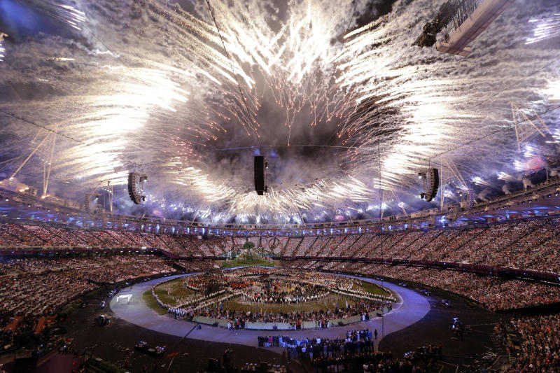 """In this Friday, July 27, 2012 photo fireworks explode during the Opening Ceremony at the 2012 Summer Olympics, in London. The International Olympic Committee expects that almost 900 million people watched part of the London Games opening ceremony on television. The IOC's television and marketing director Timo Lumme says it is the target figure for """"global viewership ... that's all eyeballs across the world."""" The final, official rating will be lower than 900 million. It counts in-home viewers watching for longer periods and will be announced within months. Lumme says around 80 of 200 national television markets have audited figures. Others are estimated. (AP Photo/Paul Sancya)"""