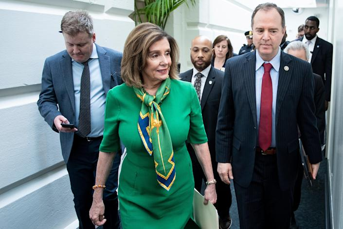Speaker of the House Nancy Pelosi, D-Calif., and House Intelligence Committee Chairman Rep. Adam Schiff, D-Calif., leave after a caucus meeting with House Democrats on Capitol Hill on Tuesday. (Photo: Brendan Smialowski AFP via Getty Images)