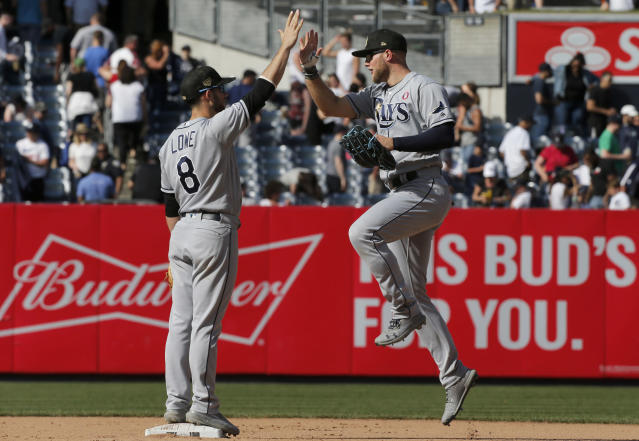 Tampa Bay Rays center fielder Austin Meadows, right, and second baseman Brandon Lowe (8) celebrate after defeating the New York Yankees in a baseball game, Saturday, May 18, 2019, in New York. Both players hit solo home runs in the teams 2-1 victory in 11 innings. (AP Photo/Jim McIsaac)