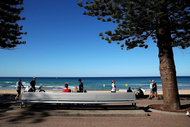People observe social distancing guidelines at Manly Beach. Source: Getty