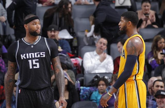 DeMarcus Cousins and Paul George make plans to grab dinner in New Orleans. (Getty Images)