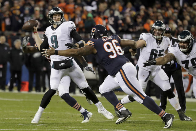 Philadelphia Eagles quarterback Nick Foles (9) throws as Chicago Bears defensive end Akiem Hicks (96) pressures him in Sunday's game. (AP)