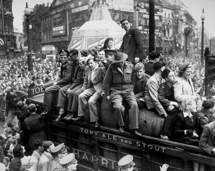 8th May 1945: A van load of beer passing through Piccadilly Circus on VE Day. The statue of Eros, protected during the war by advertising hoardings, can be seen in the background. (Photo by Keystone/Hulton Archive/Getty Images)