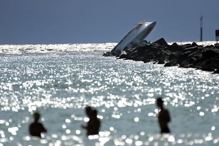<p>SEPT. 25, 2016 — An overturned boat lies on a jetty off Miami Beach, Fla. Authorities said that Miami Marlins starting pitcher Jose Fernandez was one of three people killed in the boat crash early Sunday morning. Fernandez was 24. (Joe Cavaretta/South Florida Sun-Sentinel via AP) </p>