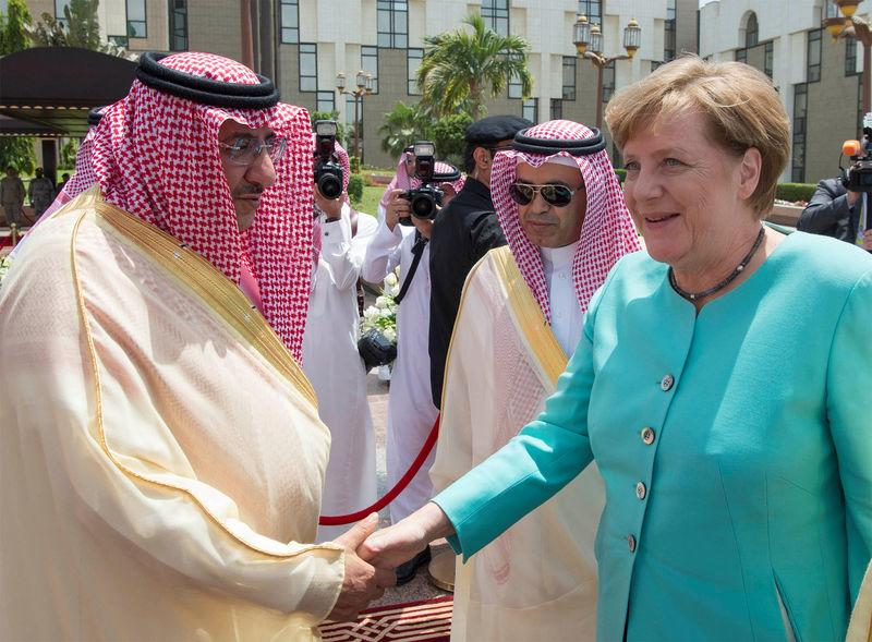 Saudi Crown Prince Mohammed Bin Nayef shakes hands with German Chancellor Angela Merkel during a reception ceremony in Jeddah
