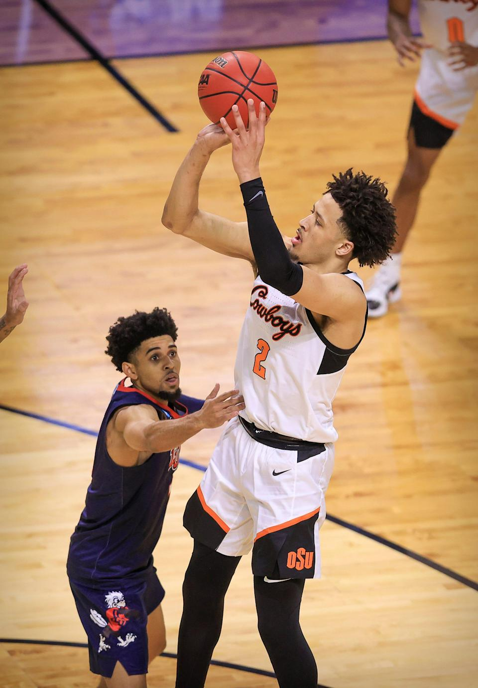 Oklahoma State's Cade Cunningham makes a jump shot against Liberty during the NCAA tournament March 19, 2021 in Indianapolis.