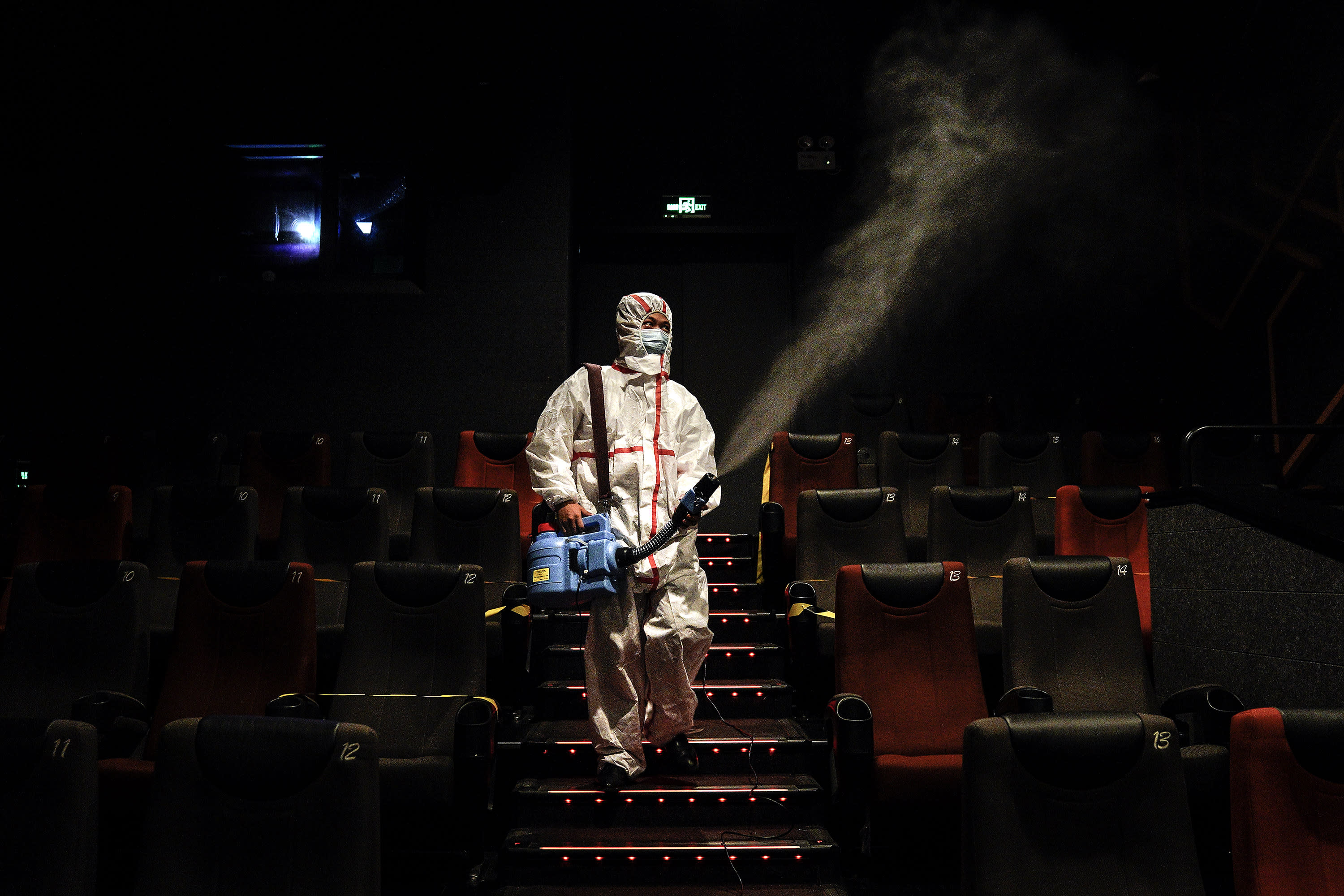 WUHAN, CHINA - JULY 20: (CHINA OUT)The employees wear the protective clothing disinfection in a cinema at Wuhan on July 20, 2020 in Wuhan ,Hubei Province,China.Taking various measures against COVID-19, cinemas in the city reopened in an orderly manner on Monday. The China Film Administration, in a circular last week, allowed cinemas in low-risk areas to resume operation with effective epidemic prevention measures in place. (Photo by Getty Images)