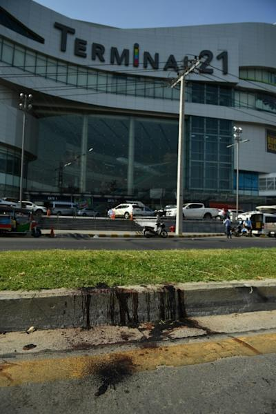 Blood stains the ground outside the mall after a 17-hour ordeal that left 29 victims dead (AFP Photo/CHALINEE THIRASUPA)