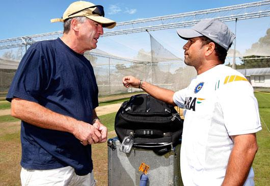 (L-R) Former Indian coach John Wright talks to Sachin Tendulkar of India after an Indian nets session at the NZC High Performance Centre on February 22, 2009 in Lincoln, New Zealand. (Photo by Martin Hunter/Getty Images)