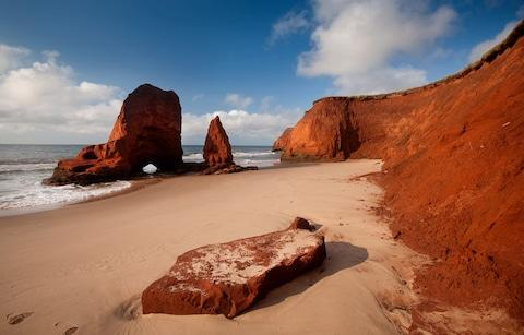 The Red Sandstone Cliffs - Credit: Getty