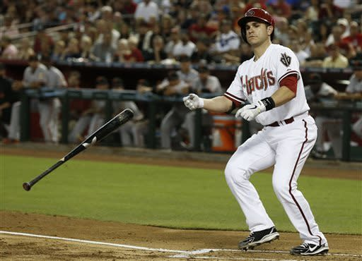 Arizona Diamondbacks' Miguel Montero tosses his bat away after earning a walk against the San Francisco Giants during the first inning in a baseball game Friday, June 7, 2013, in Phoenix. (AP Photo/Ross D. Franklin)