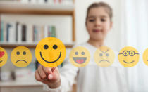 <p>With a growing number of kids borrowing their parent's iPhones, it's not entirely surprising to see emojis make the cut as we communicate through the smilies on a daily basis. <em>[Photo: Getty]</em> </p>