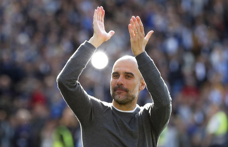 Manchester City coach Pep Guardiola celebrates after the English Premier League soccer match between Brighton and Manchester City at the AMEX Stadium in Brighton, England, Sunday, May 12, 2019. Manchester City defeated Brighton 4-1 to win the championship. (AP Photo/Frank Augstein)