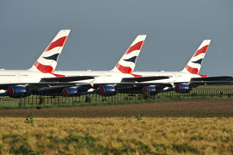 """British Airways Airbus A380 aircrafts are parked at the Chateauroux-Deols """"Marcel Dassault"""" Airport (CHR) on May 22, 2020  in Deols, central France. - Many planes from several airlines are parked at Chateauroux-Deols airport until the end of the crisis caused by Covid-19, the new coronavirus. (Photo by GUILLAUME SOUVANT / AFP) (Photo by GUILLAUME SOUVANT/AFP via Getty Images)"""
