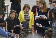 Sen. Shelley Moore Capito, R-W.Va., former lead GOP negotiator on President Joe Biden's infrastructure package, is met by reporters as she walks to the chamber for a vote, at the Capitol in Washington, Thursday, June 10, 2021. (AP Photo/J. Scott Applewhite)