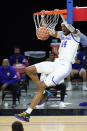 DePaul's Nick Ongenda dunks the ball during the first half of an NCAA college basketball game against Western Illinois, Wednesday, Dec. 23, 2020, in Chicago. (AP Photo/Charles Rex Arbogast)