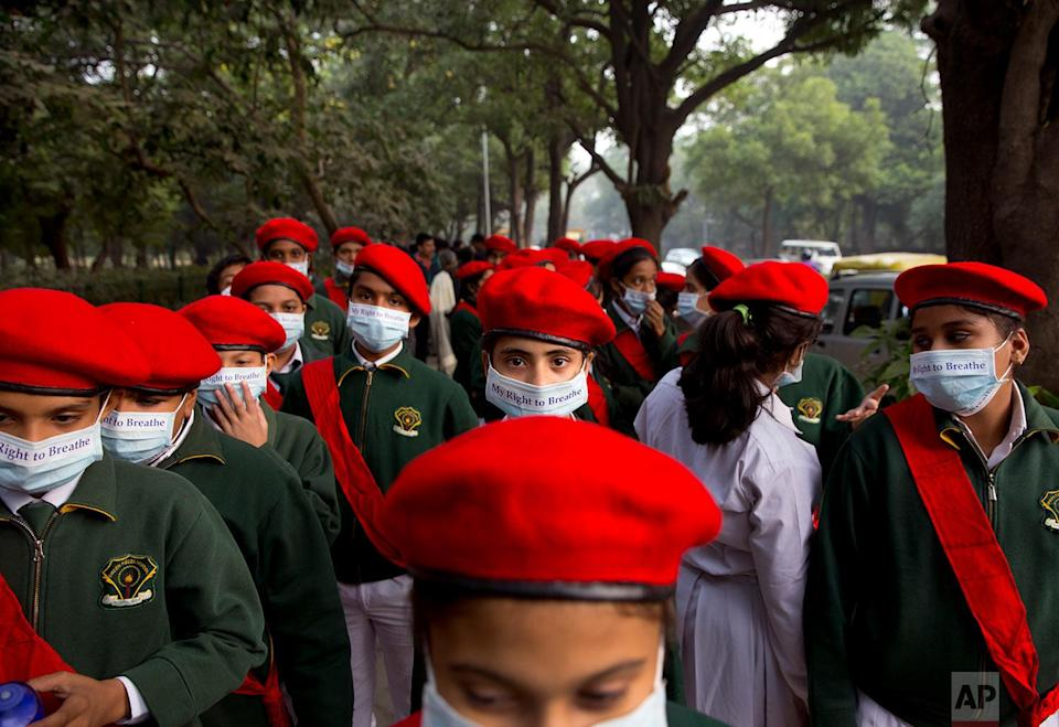 <p>School children take out a march to express their distress on the alarming levels of pollution in the city, in New Delhi, India. Thick smog has constricted India's capital this week, smudging landmarks from view and leaving residents frustrated at the lack of meaningful action by authorities. The air was the worst it has been all year in New Delhi, with microscopic particles that can affect breathing and health spiking to 75 times the level considered safe by the World Health Organization. (AP Photo/Manish Swarup) </p>
