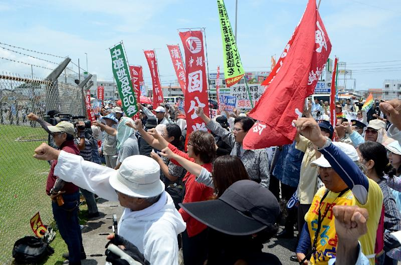 People protest against the US military presence in front of the US Kadena Air Base in Cyatan, Japan's Okinawa prefecture, in 2016
