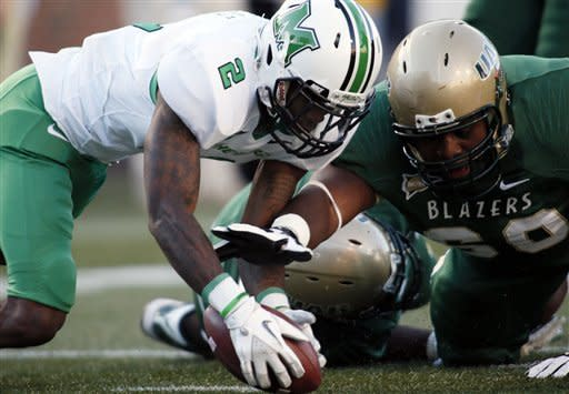 Marshall defensive back Derrick Thomas (2) recovers a fumble past UAB's offensive lineman Kaycee Ike (60) in the first half of an NCAA college football game at Legion Field in Birmingham, Ala., Saturday, Nov. 10, 2012. (AP Photo/Hal Yeager)
