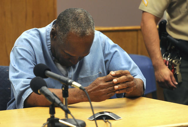 <p>Former NFL football star O.J. Simpson reacts after learning he was granted parole at Lovelock Correctional Center in Lovelock, Nev., on Thursday, July 20, 2017. Simpson was convicted in 2008 of enlisting some men he barely knew, including two who had guns, to retrieve from two sports collectibles sellers some items that Simpson said were stolen from him a decade earlier. (Jason Bean/The Reno Gazette-Journal via AP, Pool) </p>