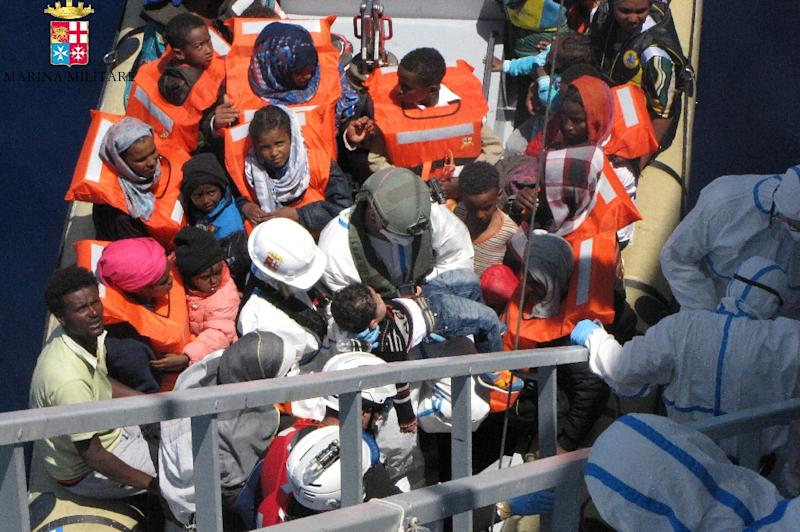 This handout picture released by the Italian Navy on May 4, 2015 shows women and children during a rescue operation of migrants off the coast of Sicily on May 3, 2015 (AFP Photo/)
