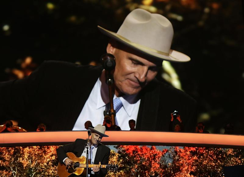 Singer James Taylor performs during the Democratic National Convention in Charlotte, N.C., on Thursday, Sept. 6, 2012. (AP Photo/Charles Dharapak)