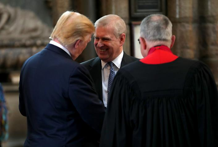 Prince Andrew, center, with Donald Trump, left