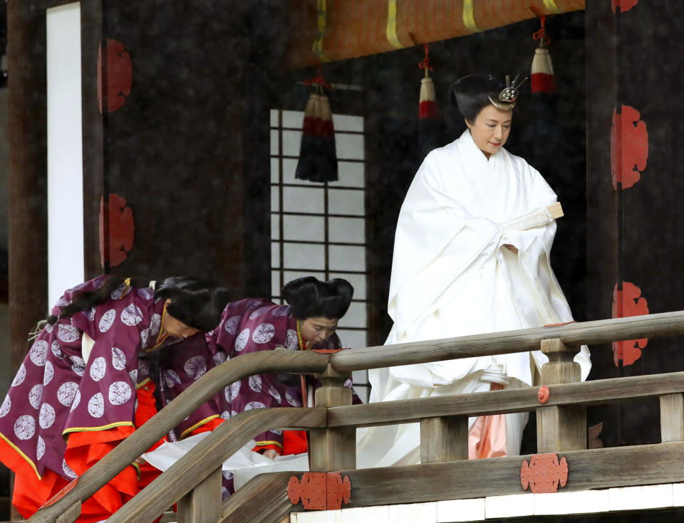 """Japan's Empress Masako leaves after praying at """"Kashikodokoro"""", one of three shrines at the Imperial Palace, in Tokyo, Tuesday, Oct. 22, 2019. Emperor Naruhito and Empress Masako visited three Shinto shrines at the Imperial Palace before Naruhito proclaims himself Japan's 126th emperor in an enthronement ceremony. (Kyodo News via AP)"""